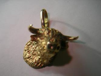 cabeza toro oro plata
