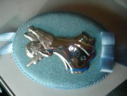 medalla cuna
